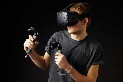 Man In Studio Wearing Virtual Reality Headset Playing Game